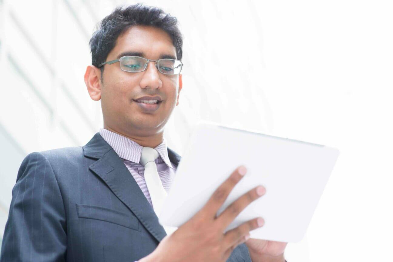 Indian businessman using computer tablet