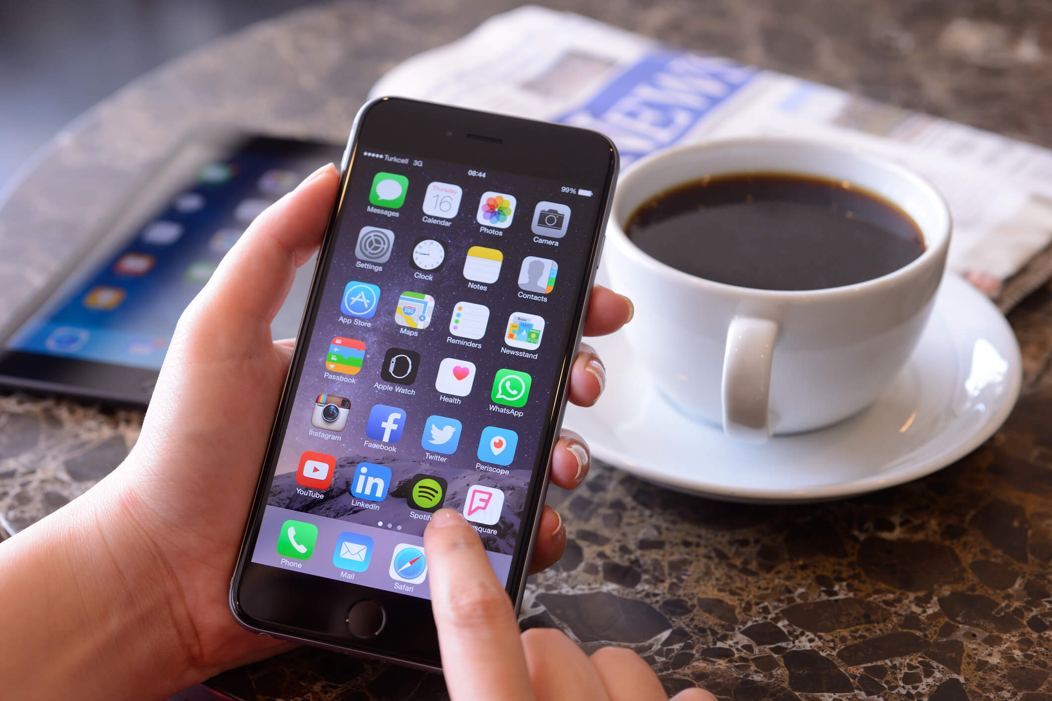iPhone User with Coffee
