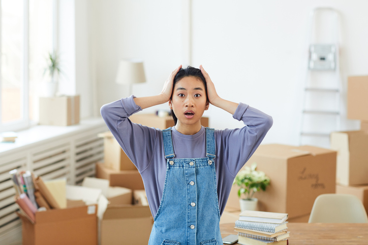 Young Asian Woman Panicking when Moving Out